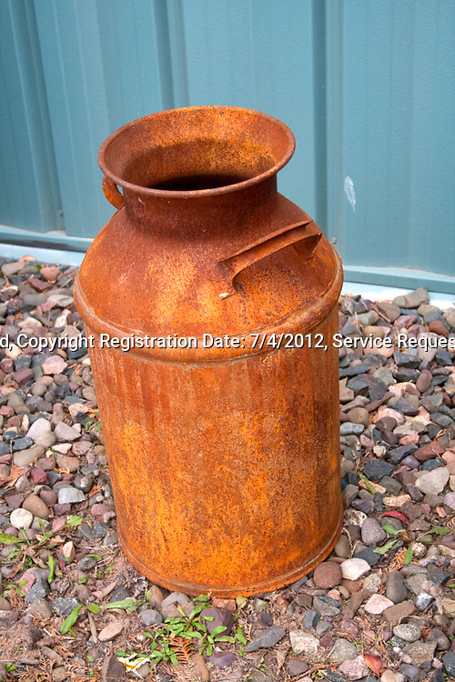 Rusted antique old farm milk can. Business and Industrial Park. Shell Lake Wisconsin WI USA