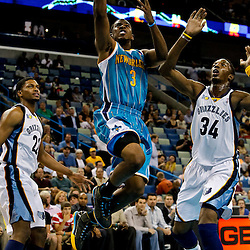 October 9, 2010; New Orleans, LA, USA; New Orleans Hornets point guard Chris Paul (3) drives and shoots over Memphis Grizzlies center Hasheem Thabeet (34) during the first quarter of a preseason game against the Memphis Grizzlies at the New Orleans Arena. Mandatory Credit: Derick E. Hingle