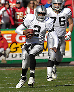 Oakland Raiders quarterback Aaron Brooks (2) rushes up the middle in the first quarter against Kansas City at Arrowhead Stadium in Kansas City, Missouri, November 19, 2006.<br />