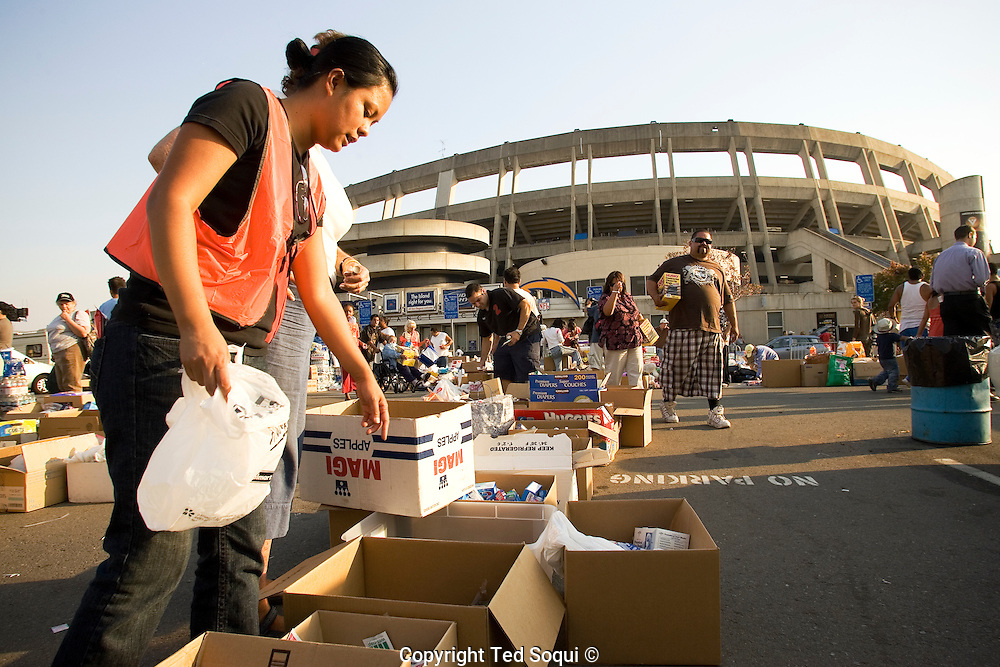 Qualcomm stadium houses 12-15 thousand area evacuees. San Diego area wild fires.