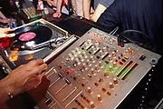 DJ's hands on the decks at 333 Old Street London April 2002