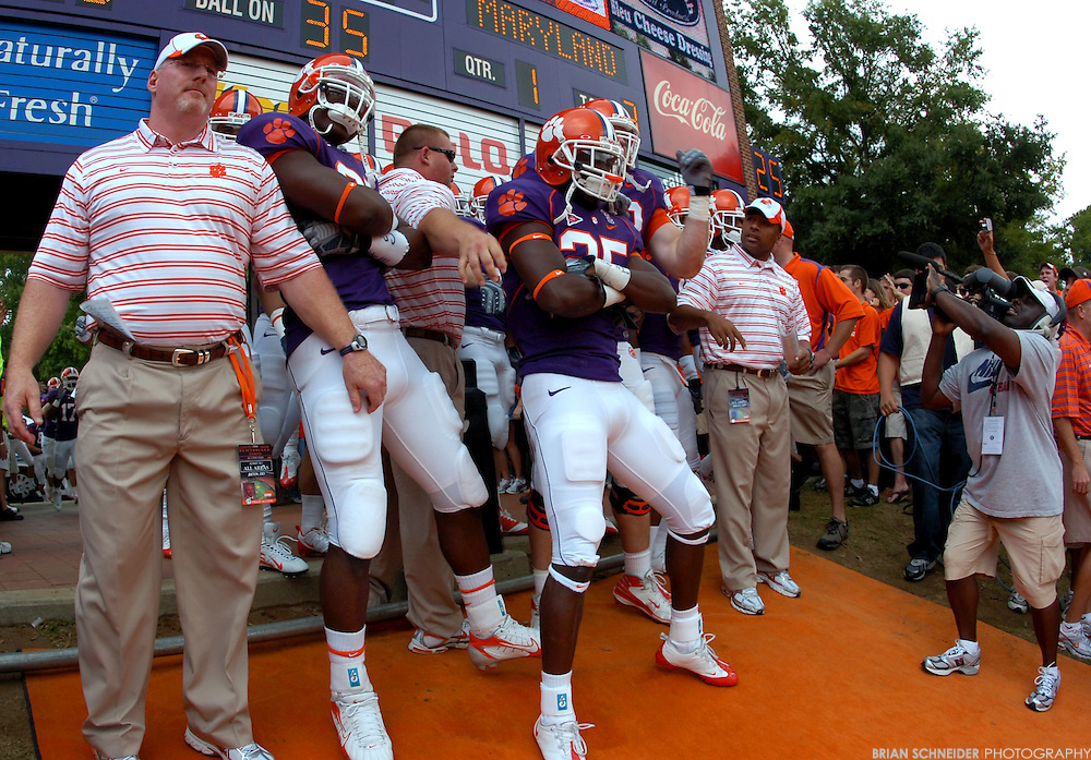 Sep 27, 2008; Clemson, SC, USA; Clemson Tigers defensive end Kourtnei Brown (90) and defensive back Michael Hamlin (25) after touching Howard's Rock before the game against Maryland at Memorial Stadium. Touching the Rock and Running Down the Hill is consider the 25 Most Exciting Seconds in College Football and a Clemson tradition.  Mandatory Credit: Brian Schneider-US PRESSWIRE