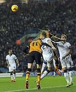 Charlie Taylor of Leeds United clears from Ahmed Elmohamady &amp; Sam Clucas of Hull City during the Sky Bet Championship match at Elland Road, Leeds<br /> Picture by Graham Crowther/Focus Images Ltd +44 7763 140036<br /> 05/12/2015