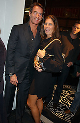TIM JEFFERIES and ELIZABETH SALTZMAN at a party hosted by Versace during London Fashion Week 2005 at their store in Slaone Street, London on 19th September 2005.<br />