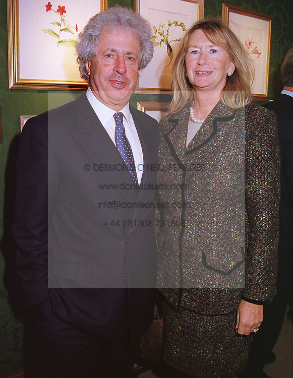MR & MRS MARTYN ARBIB the multi millionaires, at a party in London on 17th May 1999.MSB 7