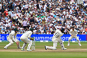 Chris Woakes of England hits the ball over the boundary for six runs during the International Test Match 2019 match between England and Australia at Edgbaston, Birmingham, United Kingdom on 3 August 2019.