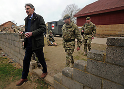 © Licensed to London News Pictures. 09/03/2012. Copedown Hill, UK. Secretary of Defence Philip Hammond (L) leaves the base with Brigadier Doug Chalmers after visiting troops who are being deployed to Afghanistan next month. The 12thMechanized Brigade (12 Mech Bde) at Copehill Down, Salisbury Plain Training Area, Wiltshire,on FRIDAY 09 MARCH 2012, as it prepares to deploy to Helmand Province, Afghanistan, on Operation Herrick 16, in the Spring of this year. The Brigade were performing a dynamic demonstration of combined Afghan/ISAF operations supported by surveillance assets and casualty evacuation capability. Tornado GR4 fast jest ground support was also displayed.. Photo credit : Stephen SImpson/LNP