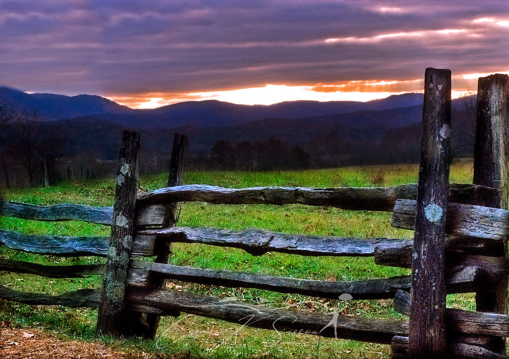 The sun sets behind an old wooden fence in Cades Cove in the Smoky Mountains. The cove is listed on the National Register of Historic Places because of the buildings on the site that give a glimps of Appalachian pioneer life. (Photo by Carmen K. Sisson/Cloudybright)