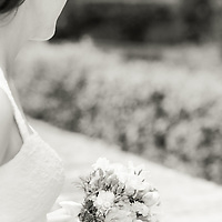 A portrait of the bride with her bouquet on her wedding day in Parc del Laberint, Barcelona, Spain.