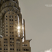The sun reflecting for a moment off some of the windows of Manhattan's Chrysler Building
