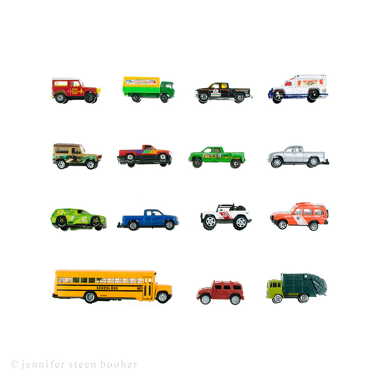 Still life of toy trucks on a white background.