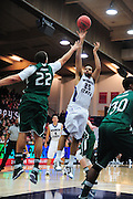 November 28, 2011; Moraga, CA, USA; Weber State Wildcats forward Byron Fulton (25) shoots over Saint Mary's Gaels forward Rob Jones (22) during the first half of the Shamrock Office Solutions Classic championship game at McKeon Pavilion. The Gaels defeated the Wildcats 87-70.