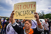 25 MAY 2014 - BANGKOK, THAILAND: A protestor opposed to the military junta  at a demonstration at Victory Monument in Bangkok. Public opposition to the military coup in Thailand grew Sunday with thousands of protestors gathering at locations throughout Bangkok to call for a return of civilian rule and end to the military junta.     PHOTO BY JACK KURTZ
