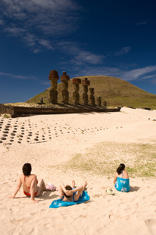 Sunbathers and moai at Anakena Beach Easter Island, Chile
