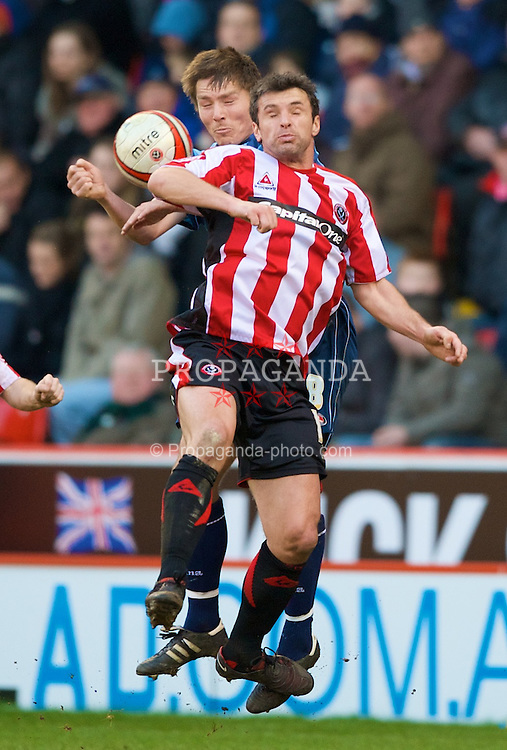 SHEFFIELD, ENGLAND - Saturday, March 1, 2008: Charlton Athletic's Matthew Holland and Sheffield United's Gary Speed during the League Championship match at Bramall Lane. (Photo by David Rawcliffe/Propaganda)