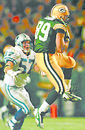 (Published caption 11/3/97) Tight end Mark Chmura beats Lions linebacker Stephen Boyd down the middle for a 28-yard reception in the second quarter.