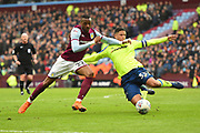 Derby County defender Curtis Davies (33) clears the ball with Aston Villa striker Jonathan Kodija (22) attacking during the EFL Sky Bet Championship match between Aston Villa and Derby County at Villa Park, Birmingham, England on 28 April 2018. Picture by Jon Hobley.