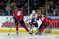 KELOWNA, CANADA - MARCH 9:  Martin Lang #22 of the Kamloops Blazers is checked by Dalton Gally #3 and Leif Mattson #28 of the Kelowna Rockets during second period on March 9, 2019 at Prospera Place in Kelowna, British Columbia, Canada.  (Photo by Marissa Baecker/Shoot the Breeze)