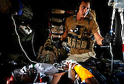 A pararescueman with the 129th Expeditionary Rescue Squadron, cares for a wounded Afghan National Army Soldier, Hemland Province, Afghanistan. Sergeant Landwerlen will provide care to the injured soldier until they can safely deliver him to a hospital.