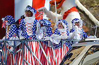 Children in patriotic costumes wave from the Uncle Sam's Top Hat float in the Macy's Thanksgiving Day Parade.