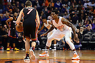 Jan 3, 2017; Phoenix, AZ, USA;  Phoenix Suns guard Eric Bledsoe (2) defends Miami Heat guard Goran Dragic (7) in the first half of the NBA game at Talking Stick Resort Arena. The Suns won 99-90. Mandatory Credit: Jennifer Stewart-USA TODAY Sports