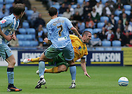Coventry - Saturday August 9th, 2008: Lee Croft of Norwich City is fouled by Guillaume Beuzelin of Coventry City during the Coca Cola Championship match at The Ricoh Arena, Coventry. (Pic by Michael Sedgwick/Focus Images)