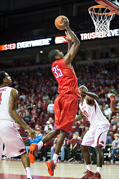 FAYETTEVILLE, AR - NOVEMBER 18:  Yanick Moriera #35 of the SMU Mustangs goes up for a shot against the Arkansas Razorbacks at Bud Walton Arena on November 18, 2013 in Fayetteville, Arkansas.  The Razorbacks defeated the Mustangs 89-78.  (Photo by Wesley Hitt/Getty Images) *** Local Caption *** Yanick Moriera