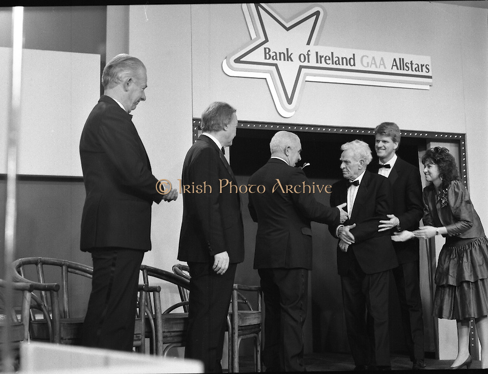 "B.O.I. GAA Allstars  (R96)..1989..03.02.1989..02.03.1989..3rd February 1989..The Awardsfor the B.O.I.Allstars were held tonight in the Burlington Hotel,Dublin. The list of the winnersis as follows..1989 - HURLING ALL STARS J. Commins (Galway), A. Fogarty (Offaly), E. Cleary (Wexford), D. Donnelly (Antrim), Conal Bonnar (Tipperary), B. Ryan (Tipperary), S. Treacy (Galway), M. Coleman (Galway), D. Carr (Tipperary), E. Ryan (Galway), Joe Cooney (Galway), O. McFetridge (Antrim), P Fox (Tipperary), Cormac Bonnar (Tipperary), N. English (Tipperary)."" 1989 - FOOTBALL ALL STARS Gabriel Irwin (Mayo), Jimmy Browne (Mayo), Gerry Hargan (Dublin), Dermot Flanagan (Mayo); Connie Murphy (Kerry), Conor Counihan (Cork), Anthony Davis (Cork); Teddy McCarthy (Cork), Willie Joe Padden (Mayo); Dave Barry (Cork) Larry Tompkins (Cork), Noel Durkin (Mayo); Paul McGrath (Cork), Eugene McKenna (Tyrone), Tony McManus (Roscommon).""..Image shows Paddy collins receiving his award as all time hurling allstar. John Dowling, President of the GAA is presenting the award as An Taoiseach, Charles Haughey and Frank O'Rourke, Deputy Chief Executive, Bank of Ireland look on."
