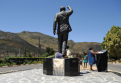 Dec. 8, 2013 - Cape Town, Western Cape, South Africa - Visitors place flowers at the statue of Nelson Mandela at the entrance of the Groot Drakenstein Prison formerly known as the Victor Verster Prison in Paarl, just outside of Cape Town. The statue is at the place Nelson Mandela walked out of prison, a free man, on 11 February 1990, PAARL, SOUTH AFRICA, Sunday, 8th December 2013. Picture by Roger Sedres / i-Images (Credit Image: © Roger Sedres/i-Images/ZUMAPRESS.com)