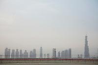 Dubai, UAE, Dubai?s skyline from Nad Al Sheba Camel Racetrack