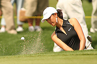 March 27, 2005; Rancho Mirage, CA, USA;  15 year old amateur Michelle Wie hits her ball out of a bunker to help save par on the 9th hole during the final round of the LPGA Kraft Nabisco golf tournament held at Mission Hills Country Club.  Wie shot a 1 under par 71 for the day and an even par 288 for the tournament and finished tied for 14th and won the award for low amateur.<br />Mandatory Credit: Photo by Darrell Miho <br />&copy; Copyright Darrell Miho