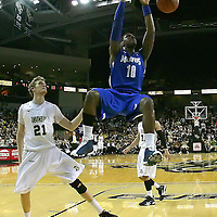 Memphis forward Tarik Black (10) slams the ball past Central Florida forward P.J. Gaynor (21) during a Conference USA NCAA basketball game between the Memphis Tigers and the Central Florida Knights at the UCF Arena on February 9, 2011 in Orlando, Florida. Memphis won the game 63-62. (AP Photo: Alex Menendez)