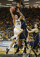 February 19 2011: Iowa Hawkeyes forward Andrew Brommer (20) puts up a shot over Michigan Wolverines forward Jordan Morgan (52) during the first half of an NCAA college basketball game at Carver-Hawkeye Arena in Iowa City, Iowa on February 19, 2011. Michigan defeated Iowa 75-72 in overtime.