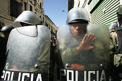 Riot police stand guard in La Paz, Bolivia. Three weeks of protests that have rocked Bolivia led to President Mesa offering his resignation, for the second time this year, to congress. Blockades, protests and concentrations have brought the country to a standstill and confrontations between police and protestors happen daily.  At the center of the conflict is the indigenous movement's desire to nationalize gas and rewrite the constitution. Congress must now meet to decide of they will accept the president's resignation.
