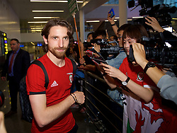 NANNING, CHINA - Monday, March 19, 2018: Wales supporters greet Joe Allen as the team arrive at Nanning International Airport for the 2018 Gree China Cup International Football Championship. (Pic by David Rawcliffe/Propaganda)
