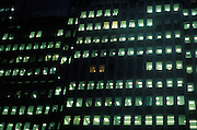 exterior of illuminated office at night