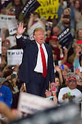 Republican presidential candidate billionaire Donald Trump waves to supporters during a campaign rally at the Myrtle Beach Convention Center November 24, 2015 in Myrtle Beach, South Carolina.