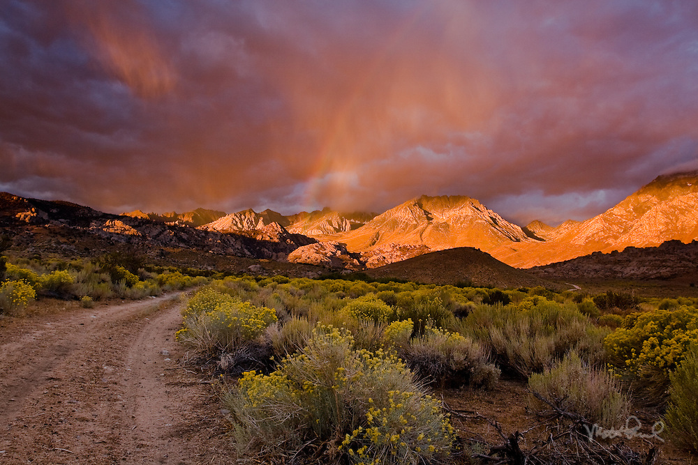 Stormy Eastern Sierra Sunrise. After the initial incredible alpenglow it began to rain over Mt Humphrey creating a rainbow from the direct sunlight.