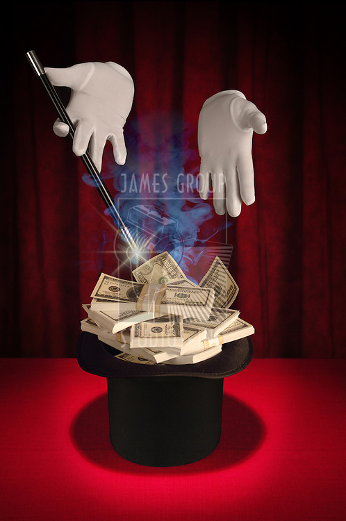White gloved hands holding a magic wand above a magician's top hat filled with cash producing a spark and smoke on a red background
