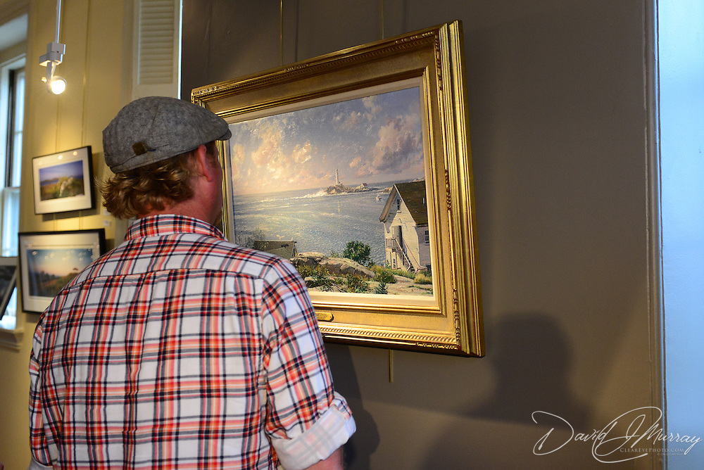 Fans admiring new work by artist John Stobart at The Discover Center in Portsmouth, NH.