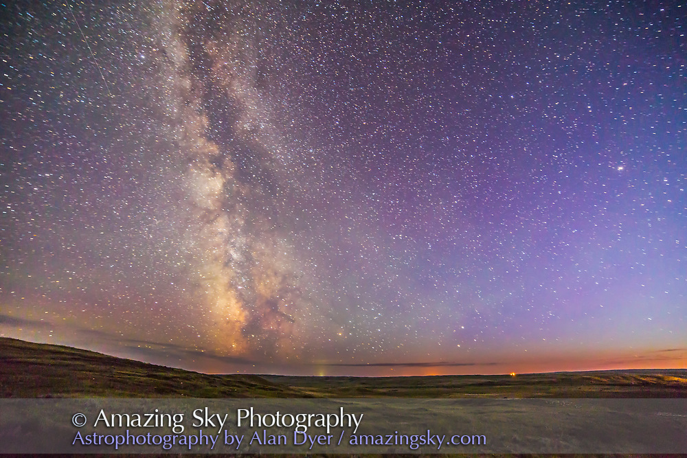 Mars and Saturn paired at lower right in Libra, with the Milky Way at left, in the last glow of twilight, over Grasslands National Park, Saskatchewan, August 25, 2014. Grasslands is a Dark Sky Preserve and few lights are visible here from areas outside the Park. Scorpius and Sagittarius are visible low on the southern horizon.<br /> <br /> This is a single exposure taken from near the 70 Mile Butte trailhead parking area. This is with the 14mm lens and Canon 6D for 60 seconds at f/2.8 and ISO 2500.