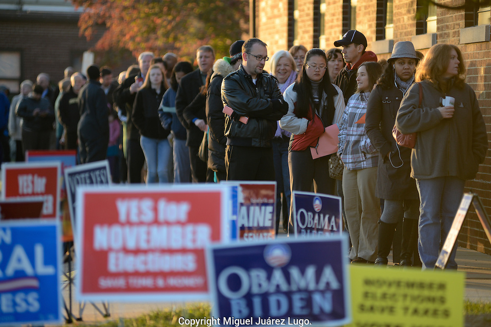 MANASSAS, VA - NOV 06, 2012:   Voters queue on a cold election day morning at Jeannie Dean Elementary school in Prince William County, Virginia, a crucial swing county in a critical swing sate. President Barack Obama won the state in the 2008 election. (Photo by Miguel Juárez Lugo)