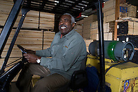 Senior forklift truck driver at warehouse