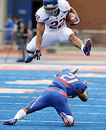Boise State's Doug Martin leaps over defensive back Jamar Taylor during the spring football scrimmage on Saturday afternoon, April 16th.