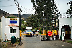 NO WEB/NO APPS - (Text available) One of the many private security checkpoints present at the entrance to the exclusive urbanizations of Santiago de Surco', in Lima, Peru in May 2017. In Peru's capital Lima, a three-meter-high concrete wall topped with reels of razor wire separates two areas. The so-called 'Wall of Shame' - sometimes nicknamed 'Peru's Berlin Wall' - divides the urbanisation of Las Casuarinas, where some of the country's richest inhabitants live, and the poor suburb of Vista Hermosa next door. It was initially put up over fears that the inhabitants from the poor neighbourhood would steal from wealthy fellow citizens living nearby. On the rich side of the wall, the price for a square meter can exceed 2,000 dollars. To enter the area, you must show your ID to the guards watching the gate at the bottom of the hill. Former high-ranking politicians and bank directors live here. Their houses are surrounded by lush gardens and swimming pools despite the scarcity of water. Meanwhile, on the San Juan de Miraflores side, residents often fall victim to robbery and theft. They live in houses of barely 25m², made from scrap material, surrounded by the sand and earth characteristic of Lima's desert landscape. Photo by Giacomo D'Orlando/ABACAPRESS.COM