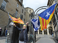 Pictured: Supporters waved Catalonian flags outside court prior to her extradition hearing.<br /> <br /> Former Catalan government minister Professor Clara Ponsati appeared in court in Edinburgh, Scotland today, in response to a European arrest warrant issued by the Spanish prosecutors following the disputed Catalan independence referendum last year, which Spain has ruled illegal.<br /> <br /> © Dave Johnston/ EEm