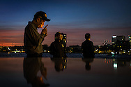 Nederland, Rotterdam, 31 okt  2015<br /> Koreaanse matrozen van een oorlogsschip dat afgemeerd ligt op de Kop van Zuid, roken en sigaret en checken hun e-mail op een smartphone. <br /> <br /> Foto: (c) Michiel Wijnbergh