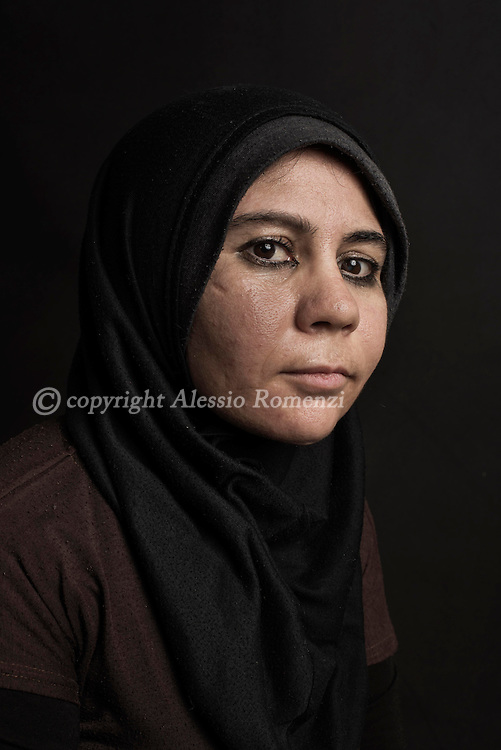 "Lebanon, Jbeil region. Aisha Hassan, 20, is from Idlib. She was forced to flee Syria two years ago. Since then she lives along with her husband and two children Khaled (7) and Youssef (4) in a one room barrack in the outskirt of Jbeil/Byblos, about 35 km north of Beirut. ""The objetc I care the most is the ring that my sister gave me as present when we still were inside Syria. At that time, I was a little girl and since then the ring is always with me. Zeinab, my beloved sister, is still inside Idlib. Due to the war comunications are extremely difficult with her. I love her so much, I truly miss her"". Alessio Romenzi"