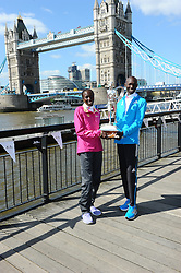 (L-R) Edna Kiplagat with Wilson Kipsang during the photocall for the 2014 London Marathon Elite Runners Race Winners, Tower Hotel, London, United Kingdom. Monday, 14th April 2014. Picture by Chris Joseph / i-Images