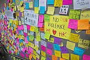 The wall of the LegCo (Now know as Lennon Wall or John Lennon Wall ) building is extensively decorated with thoughts and wishes.Pro-democracy  student protesters hold fast through the night in Hong Kong.Police and riot police are back in place.30th September 2014<br /> Pic Jayne Russell +852 97578607.<br /> Date-30.09.14